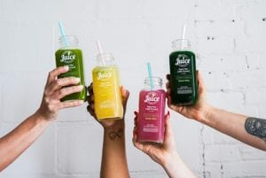 How To Write A Killer Influencer Brief In 10 Steps - a variety of colorful juices held up by four hands